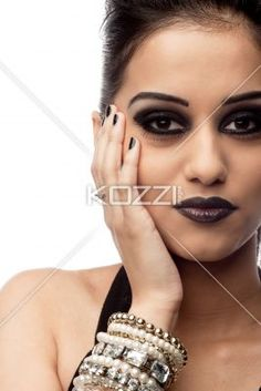 close-up of a pretty young indian woman. - Close-up portrait of a pretty young indian woman over white background, Model: Kiran Bahugun