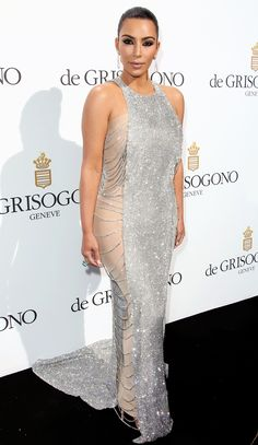 Kim Kardashian in a sparkly dress over a nude body stocking - click ahead for more Cannes style!