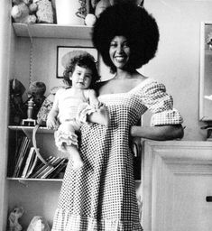 Marsha Hunt and Mick Jagger's first child, daughter Karis.    Marsha Hunt toured as back-up singer with The Rolling Stones ('Gimme Shelter') and had an affair with Mick Jagger which resulted in his first child.  The sass of that Afro, and child on hip is ridiculous.