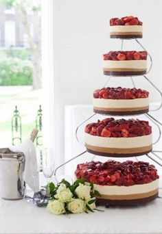 cheesecake wedding cakes- with the idea you could get the lovely Bavarian Cheesecake for the bottom and make the other sizes to go on top on the tier stand