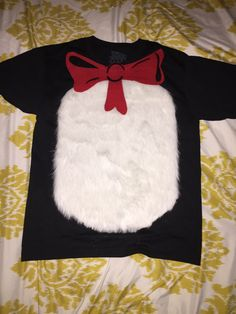 DIY simple Cat in the Hat shirt. ~all supplies from Joann Fabric... Black tee, white fur, felt and fabric glue.