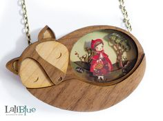 Collar Red Riding Hood. Quality wood in various shades with wolf form. Original artwork in paper cutting (Pop Up), creating different depths. I