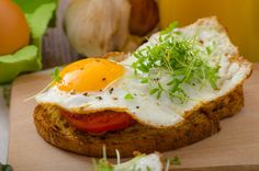 eggs and toast with tomato and red onion