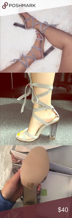 Gray, up-tie heels! Brand new. Did not fit me, still with original boxing and wrapping. Size 3 kids , 5 in woman, gray color and clear heel makes it classy! ego Shoes Heels