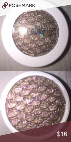 "Never used COLOURPOP SO QUICHE Super shock shadow New untouched only opened to take photos COLOURPOP SO QUICHE super shock shadow! When COLOURPOP says 'there are no words in the dictionary' to describe this shadow it's true - even photographing it I was mesmerized by the blend and pop of colors...how to properly describe? A soft olive with highly reflective gold and pink and violet glittery chrome and metallic finish. As COLOURPOP writes this is ""the F**king Queen of Shadows"". I think that's…"