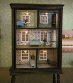A dollhouse made from an old dresser. This is such a great idea!