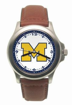 Michigan Rookie Watch Logo Art. $26.85. Coordinating Colored Dial Ring. 2 Year Warranty. Bold Logo On Dial. Padded Leather Strap. Water Resistant. Save 29% Off!