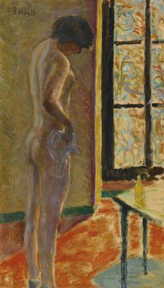 Pierre Bonnard 1867 - 1947 NU À LA FENÊTRE Stamped Bonnard (upper left) Oil on canvas 30 1/8 by 17 1/4 in. Painted circa 1922.