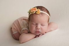 Newborn girl outfit made of soft stretchy knit fabric, losos color for the bottom part and dainty lace, floral design for the top part. Perfect as newborn photo prop.Size: newbornReady to shi...