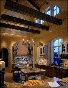 Tuscan Kitchen Wooden beams, terra-cotta tiles from Italy and hand-painted frescoes of Italian vineyards — this kitchen cooks up Italian flavor from floor to ceiling. Küchen Design, Layout Design, House Design, Design Ideas, Tile Design, Garden Design, Design Styles, Design Inspiration, Beautiful Kitchens