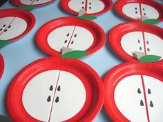 For decorations, have bowl with different color apples, a green table cloth and red plates and cutlery