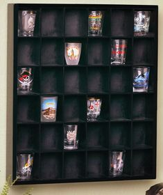 Collector's Shot Glass Display Shelf  $8.95 -- For Lego MiniFigs. Shipping is 7.50. Cheaper than the one I found on eBay.