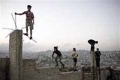 ISRAEL. Palestine. 2007. Boys playing on a hill overlooking Bethlehem. by Christopher Anderson