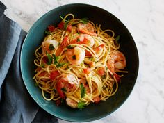 Shrimp Scampi : Ready to eat in only 25 minutes, Robert Irvine's weeknight-friendly dinner features tender shrimp tossed with tomatoes and pasta in a white wine-butter sauce.