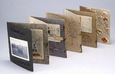 Memoria Technica by Lisa Kokin. Cardboard photo frames, thread, found photos, mixed media collage, 8 x 50 x 8 inches, 2002