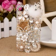 White Bling Crystal Diamond Jewelry Pearl Fur Hard Cover Case For Iphone 5 5S. Condition: 100% Brand New. Quantity: 1 PC. Features: Color as the photo shown. Don't use hard force to pull it. Perfectly fits iPhone 5 5S. Complete access to all control buttons without removing the case. 100% handmade product with fashionable design and high quality. Cover without front side. Clear plastic material so can plug-in the phone.