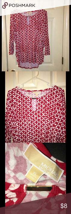 Michael Kors Red and White Top XL Knit top with 3/4 sleeves.  Gold bar accent at neckline.  Size XL.  Michael Kors.  Good condition. Red and white print.  Important:   All items are freshly laundered as applicable prior to shipping (new items and shoes excluded).  Not all my items are from pet/smoke free homes.  Price is reduced to reflect this!   Thank you for looking! Michael Kors Tops