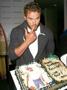 Kellan Lutz sneaks a taste from his portrait of a birthday cake at the launch of his Abbot & Main spring 2014 collection at Bloomingdale's Beverly Center in L.A. http://www.people.com/people/gallery/0,,20799252,00.html#30123848