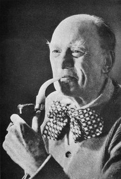 Aleister Crowley smoking a pipe and wearing a clown's bow tie.  Oh well, do what thou wilt ...