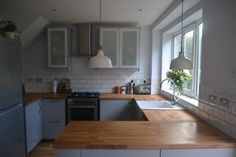 Kitchen renovation reveal. Ikea Veddinge grey kitchen with wood worktop and white subway tiles.  My lamps!! Yay. Sp