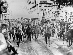 Pancho Villa y Zapata entrando triunfantes a Ciudad de México.