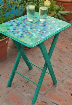 Mesa con venecitas (Mosaic table) by Mery Lozada.  $500