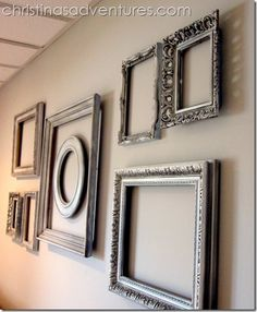spray paint & glaze ugly thrift store frames to make a gallery wall of empty frames!