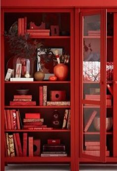 Need an adorable red book case like this one, perfect for my stuff. And my favorite books...  ~~  Houston Foodlovers Book Club