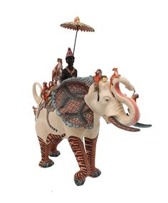 Sculptor, Alex Sibanda, celebrates the connections shared by India and Africa in this stunning Elephant Rider, which has a troop of small red monkeys cavorting playfully on an elephant, painted with tiger stripes and exotic patterns by Jabu Nene.