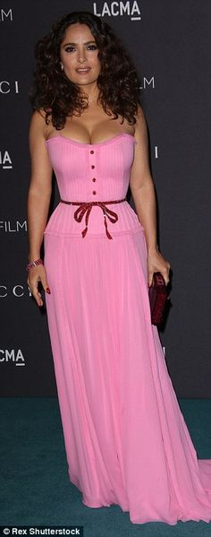 Dreamy: Salma Hayek showed off her cleavage in a light pink gown, while Gwyneth Paltrow donned a shimmering jade green mini dress