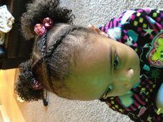 Crossing cornrow bangs w/Afro-puffs.  Toddler hair