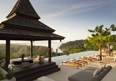 Still fresh from its 2014 opening, Anantara's newest Phuket property (the other, Anantara Mai Khao, lies 40 minutes south) manages a perfect balance of jungle-shrouded seclusion and spot-on service with sleek, modern design. The glamorous result feels like something out of a James Bond movie—especially at the resort's just-completed Residence Villas. The mini compounds, each self-contained and consisting of villas with three to seven bedrooms, sit high on the property's hillside overlooking…