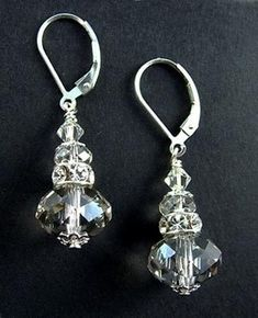 Crystal Silver Earrings  by Michele Rose  The Crystal Silver Earring kit will enhance anything you wear but we think these are the perfect earrings for a wedding ensemble. Featuring brilliant Swarovski crystal silver shade rondells and sterling silver findings these earrings are super sparkly and will match almost anything.