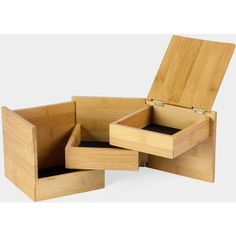 This multi-level cube-shaped storage box swivels open to reveal three lined compartments. Ideal for storing and organizing jewelry and accessories. Made by Umbr...