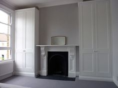 white built in wardrobe doors around fireplace - Google Search