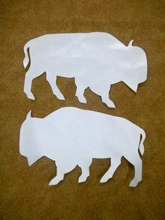 READY TO SHIP --- Priority Mail with tracking number    This set of two white satin buffalo appliqués, ready to be ironed on your regalia or what ever you decide. Instructions are included. Comes with easy to follow visual and written instructions.    Measurements 6-1/4 X 4-7/8    They can be custom ordered in another color for the same price or I can resize them to fit your design.All my appliques are individually hand drawn from my patterns and the hand cut. * Shipped after money is…