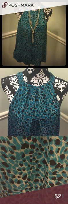 """Classic Ann Taylor Print Top Brand Ann Taylo. Size 14. Material Silk/spandex. Dry clean only. Keyhole at neck in back with button closure. Bust 20"""". Length 27.5"""". Colors grey, black and teal blue. Ann Taylor Tops"""
