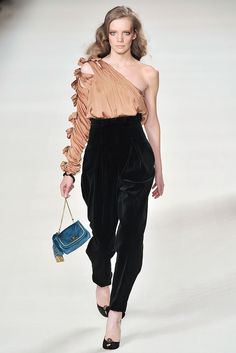 Chloé, Fall 2009 Ready-to-Wear Collection. Asymmetric blouse with multiple bow embellishment at arm. Chloé blouse has cutout detail on arm, pleating at shoulder, a concealed zip fastening at side and a nude silk chiffon lining. 100% silk. Designer color: Blush.