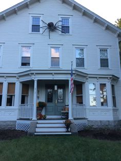 The farmhouse decorated for fall. Giant plush spider with lighted eyes is a creepy focal point!