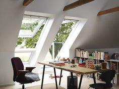 A home office filled with light and fresh air, featuring the VELUX CABRIO balcony roof window. - To connect with us, and our community of people from Australia and around the world, learning how to live large in small places, visit us at www.Facebook.com/TinyHousesAustralia