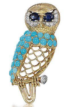 GOLD, TURQUOISE, SAPPHIRE AND DIAMOND BROOCH, CARTIER, CIRCA 1960 composed of a nice body with openwork decoration enhanced by pave round turquoise, eyes adorned with sapphires in a cobblestone circle diamond setting.