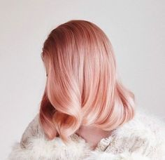 Pearlescent Rose hair color style: This soft rose gold look gives off an almost pearlescent pink appearance due to the white highlights and subtle pink lowlights. The combination of colors gives a majestic look to any woman daring enough to attempt it. This shade of coloring would work best with pale-medium skin.