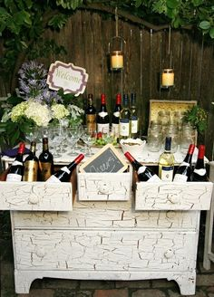 A special event or garden wedding drink station with lots of wine choices too!  Love the crackle paint job on the old vintage dresser which could also double as a potting bench!