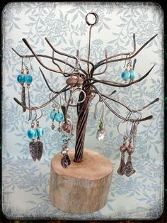 The copper tree is arranged from scrap electrical wire that they stripped the outer plastic coating from and separated the wires, pulling each down, hammering the ends and antiquing to add depth and character. Awesome!