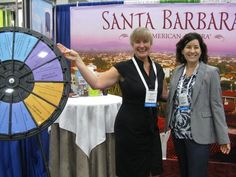 Spin the wheel and win a prize at the Santa Barbara Conference & Visitors Bureau booth. I spy some aspiring Vanna Whites! Buy this Prize Wheel at http://PrizeWheel.com/products/floor-prize-wheels/floor-and-table-prize-wheel-12-24-slot-adaptable/.