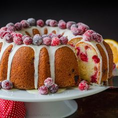 This Cranberry Bundt Cake has a soft and moist crumb and is surprisingly easy to make. It's the perfect Christmas cake covered in a simple orange glaze and studded with sugared cranberries. It is such a satisfying cake and keeps really well so you can make it ahead. Bundt cakes are probably the easiest kind of cake to make, but it looks super impressive. You'll love that juicy burst of fresh cranberry flavor in every bite. Cranberry Orange Bundt Cake Recipe, Cranberry Recipes, Easy Christmas Cookie Recipes, Christmas Desserts, Baking Recipes, Cake Recipes, Dessert Recipes, Food Cakes, Bundt Cakes