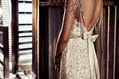 Anna Campbell Bridal | Chloe Dress | Vintage-inspired old hollywood glamorous embellished beaded wedding dress with silk bow and shoulder detail | Bridal headpiece | Rustic wedding inspiration