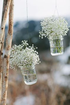 Simple mason jar decor with baby's breath, suspended from wedding arbor. Floral & Decor by Harvest Moon Events | Photography by Bacio | Location Lookout Cabin Park City Mountain | www.harvestmoonevents.com