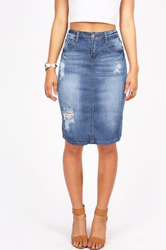Denim pencil skirt with distressing on the front. Button and zip fly closure with traditional five pockets and a vented back. Pair with tees and wedges for a casual look or dress it up with a blouse a