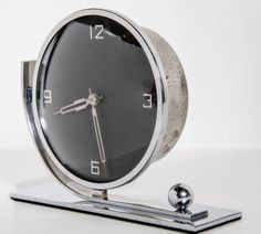 Streamline Art Deco Clock with Circular Face and Chromed Accents